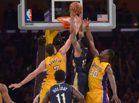 Jan 12, 2016; Los Angeles, CA, USA; New Orleans Pelicans forward Alonzo Gee (15) dunks the ball as Los Angeles Lakers forward Larry Nance Jr. (7) and forward Julius Randle (30) defend at Staples Center. The Lakers won 95-91. Mandatory Credit: Kirby Lee-USA TODAY Sports