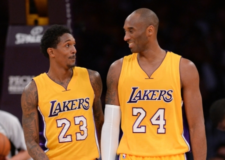Dec 15, 2015; Los Angeles, CA, USA;  Los Angeles Lakers forward Kobe Bryant (24) and guard Louis Williams (23) talk in the first half of the game against the Milwaukee Bucks at Staples Center. Mandatory Credit: Jayne Kamin-Oncea-USA TODAY Sports